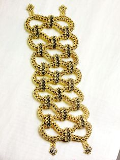 Designed by Jill Wiseman for the Dec/Jan 2013 issue of Beadwork Magazine - Designer of the Year. Infinity Bracelet.