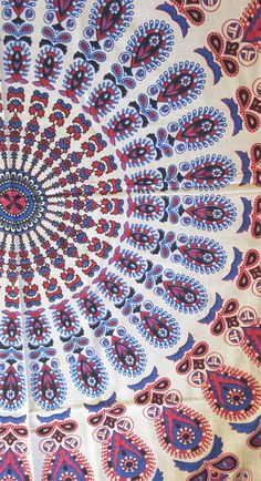 A rectangular peacock mandala tapestry comprising of foliage & floral patterns in gorgeous bright shades of blue, pink and red.