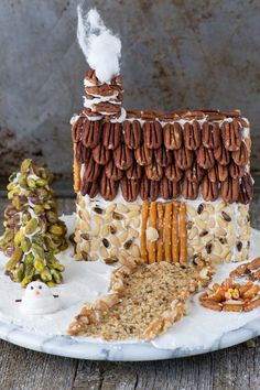 A rustic christmas gingerbread house made using nuts! Learn how to make a gingerbread house out of a butter box, plus tons of decorating ideas and the best gingerbread 'glue'!