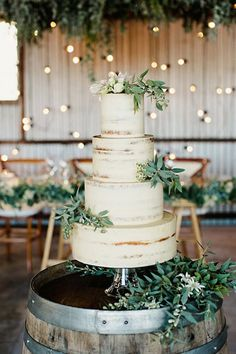 TRANSLUCENT CAKES Not quite frosted and not quite naked, the latest wedding cake craze is chic towers that merely hint at their delicious interiors. (Also note: The #greenery runneth over.)