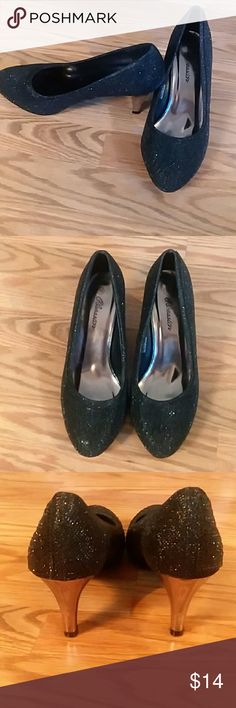 Sale ! Womens black round toe pumps size 39 Womens shoes size 39 equivalent to an 8.5/9. Beautiful black crystal embellishments with a silver heel. Heels definitely have some wear but hardly noticeable while wearing them. 2 inch heels. Perfect for any season.   Smoke and pet free home. Same day shipping. Make me an offer ! Or bundle for a discount.             😊🛍👗💕 happy poshing !! Obsession Shoes Heels