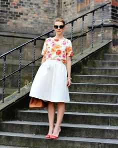 Prim and pretty in a bright floral shirt and subtly textured tea-length skirt