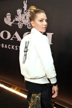 Spotted in Coach: Skylar Grey wearing the Emmanuel Hare Ray Soft White Leather Reversible Varsity Jacket and Ryderson Sneaker at #CoachBackstage for Coach Rodeo Drive (Photo credit: Getty Images)
