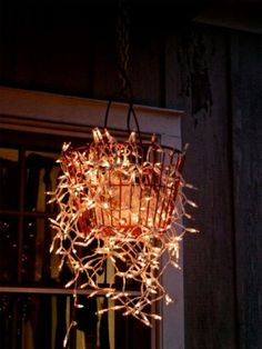 DIY outdoor chandelier using wire basket and Christmas lights ~ Outdoor Chandelier, Outdoor Lighting, Outdoor Decor, Lighting Ideas, Backyard Lighting, Diy Chandelier, Fun Backyard, Iron Chandeliers, Porch Lighting