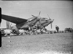 1 May 1944: Bombing – Berliners 'prepared to see it through' Armourers prepare to load 500-lb MC bombs into De Havilland Mosquito B Mark IV, DZ483 'GB-R', of No. 105 Squadron RAF at Marham, Norfolk, in preparation for a night raid on Berlin, Germany by aircraft of No. 2 Group. Two weeks later, DZ483 crashed at Marham while attempting to land on one engine, on returning from the low-level raid on Jena. Its crew, Flying Officer A J Rae and Flying Officer K S Bush, were both killed.