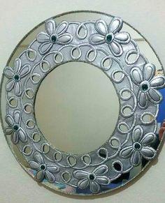 Repujado espejo