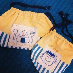 お弁当袋とコップ入れ♡ ゆるキャラさん刺繍してオリジナル感あるのにしあがりました なんとか間に合ったー!あとはスモックの丈詰めのみ✨ #handmade#embroidery#lunchbag#cupbag#kindergarten#formyson#blue#yellow#stripe#刺繍#手刺繍#入園準備#息子グッズ#お弁当袋#コップ袋#手芸部#ゆるキャラ#入園に間に合う#保育園もあと2日#ハンドメイド好きさんと繋がりたい