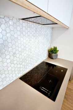 Love this tile - nice gray coloration and movement - with gray grout 50mm hexagonal carrara marble mosiac from eBay! splashback (backsplash) – 50mm hexagonal grout – Ardex magellan grey, Beaumont Tiles