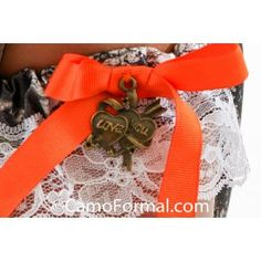 Camo garter with charm attached.Please select charm from photographed choices.This bridal wedding garter features lace, camo and ribbon and is perfect for the bride to wear and the groom to toss. Available in all camo prints.One size fits most.Made in the USA.