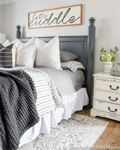 Change Up Your Master Bedroom Decor with Bedding modern farmhouse master bedroom design, neutral bedroom design, rustic bedroom decor with upholstered bed and farmhouse wood sign and farmhouse bedding with chandelier and white walls and nightstand decor Bedding Master Bedroom, Home Decor Bedding, Farmhouse Master Bedroom, Master Bedroom Design, Bedroom Furniture, Bedroom Designs, Master Suite, Bedroom 2018, Master Master