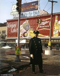 A policeman patrols 59th Street in 1964