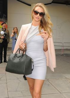 Rose Huntington Whiteley spring street style with pastel colors and Givenchy handbag