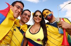 Cheerring on the team: Colombian fans gather before their side's opening win against Greec...