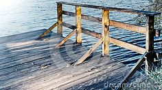 Tree bridge on the shore, lonely on the edge of a stall