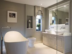 This bathroom features twin Amalfi55 basins and an Amalfi bath. The beautiful bespoke furniture by The Secret Drawer works perfectly with the gorgeous curves of the Amalfi collection.