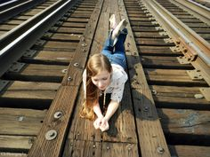 Senior picture (raiload tracks) - Chasity Sherelle Photography