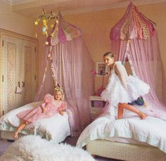 This gorgeous room below, from ElleDecor, shows how simple fabric adornments create a snuggly space for your little princess.