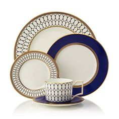 Embellished with intricate garlands, oval links and a fanciful dragon motif, this Wedgwood dinnerware evokes Europe's glorious Renaissance period. Rendered in deep blue and gold to transform any formal meal into a spectacular royal gala. Red Dinnerware, Fine China Dinnerware, Casual Dinnerware, Terracotta, Royal Crown Derby, Fall Table, China Patterns, Place Settings, Table Settings