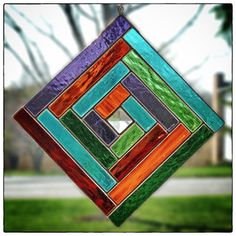 Eye of God Stained Glass Square by colorandlight on Etsy, $49.00. This design is similar to traditional textile pieces crafted by native people in western Mexico. In their beliefs, the four sides symbolize Earth, Air, Fire and Water, and Heaven's power to know what man cannot. This piece is a little over seven inches square, was handmade in my shop, and is available at www.colorandlight...