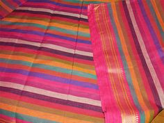 This listing is for a yard of south Indian Homespun cotton fabric in multi color horizontal stripes. Fabric has beautiful woven silk border on both side selvage to the entire horizontal length gold...