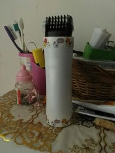 Diy trimmer holder: Method: Cut any small bottle of lotion or powder, the size of trimmer, n decorate with washi tape.