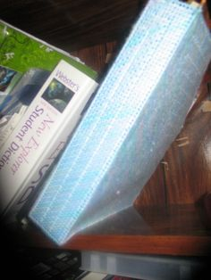 the blue one is a book holder made of plastic canvas
