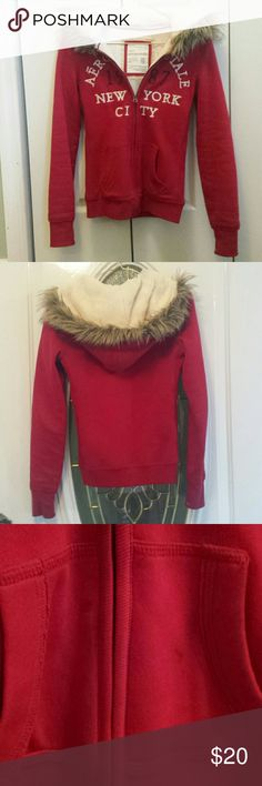Winter Aeropostale Jacket Red Aeropostale jacket with fur-lined (faux) hood. There are some small grey stains on the front pockets and the bottoms of the sleeves, but hardly noticeable. (See third photo). In good condition! Aeropostale Jackets & Coats
