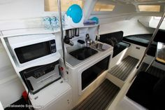 Cool, simple galley mod for the Macgregor 26X. Nice cushions and carpet.