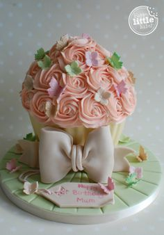 Butterflies and flowers themed giant cupcake cake.