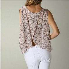 Temp 10% price drop! FLOATING HEARTS I L❤️VE this shirt!! Another perfect pic for your Spring wardrobe. The light colored floating hearts throughout, the sheer cool feel of the fabric along w/the split open back ... U cannot go wrong owning this gorgeous piece. One to dress up w/a pair of classy shorts or slacks, jewelry and heels or dress down w/sandals, jeans or shorts. Endless possibilities! Moon Collection Tops
