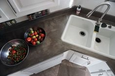Easy DIY Concrete Countertops Over existing laminate countertops for a beautiful, industrial, look in your DIY kitchen renovation.