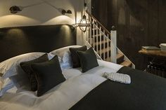   No 131 Cheltenham, Crazy Eights, Boutique Restaurant Hotel & Bar in the Cotswolds, Gloucestershire. Beautiful cozy hotel. You get homemade cookies and hot water bottles delivered to your room. It's the little things.