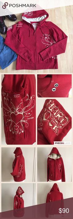 """Hard Rock Embroidered Red Hoodie Yokohama Japan For the Hard Rock fan this is a one of a kind find as you won't find another like it. Bought while visiting Yokohama Japan, this unique hoodie comes to you in excellent condition as it was only worn a handful of times. Pretty medium red with hallowed out """"Hard Rock"""" on the hood. Intricate embroidery design on the left side with """"Yokohama"""" (City in Japan) next to it. Peace & heart pins on the right pocket. Measures: 18.5"""" underarm to underarm…"""