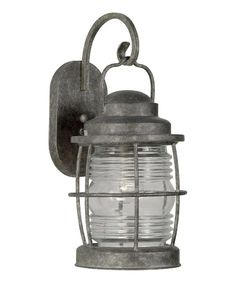 Add extra illumination to a wall or outdoor space with this maritime-inspired lantern. Its timeless design gives it a nautical vibe that traditional and transitional decorators will love.8'' W x 18'' H x 9'' DMetalRequires 100 W bulb (not included)Imported