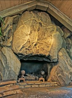"""""""I always build the roof first, and then shove the house under it."""" (Earl Young as quoted in the Ludington Daily News, October 1971 issue) Earl Young was an architect who lived most of his life. Majestic Fireplace, Charlevoix Michigan, House Slide, Unusual Buildings, Mushroom House, Michigan Travel, House On The Rock, Unusual Homes, Pet Rocks"""