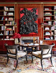 A Piotr Uklański resin painting provides a striking contrast to the library's brass-trimmed millwork | archdigest.com