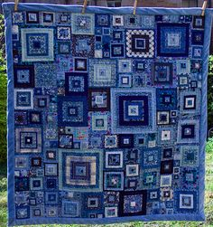 Jeweled Squares from book Glorious Patchwork by Kaffe Fassett.  Quilting was done down the center of each fabric strip, making concentric squares of quilting for each square.