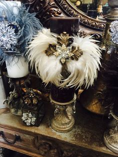 Feather and candles Tuscan Decorating, French Country Decorating, Antique Booth Displays, Crown Decor, Tuscany Decor, Tv Rooms, Movie Rooms, Game Rooms, Bottle Candles