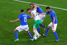 Daryl Murphy (C) of Republic of Ireland controls the ball under pressure of Andrea Barzagli (L), Leonardo Bonucci (top) and Thiago Motta (R) of Italy during the UEFA EURO 2016 Group E match between Italy and Republic of Ireland at Stade Pierre-Mauroy on June 22, 2016 in Lille, France.