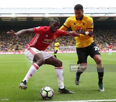 Paul Pogba of Manchester United tussles for posession with Etienne Capoue of Watford during the Premier League match between Watford and Manchester United at Vicarage Road on September 18, 2016 in Watford, England.