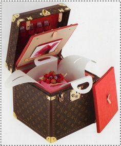 That cake knows how to travel. Louis Vuitton Cake trunk.