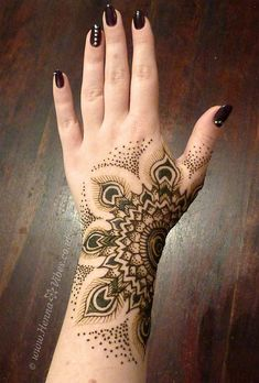 Dot work ispired peacock henna by Henna Vibes. Like the placement, and the peacock feathers