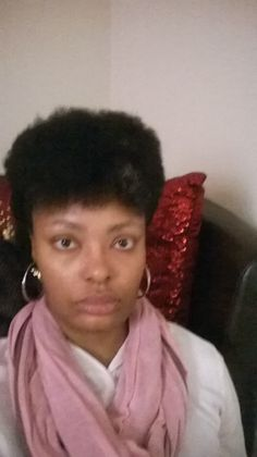 My first frohawk at 9 months post BC.  I was just playing with my hair. I look a lil busted in this pic. Lol!
