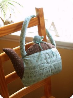 shaped pillows! (though not necessarily like a teapot)