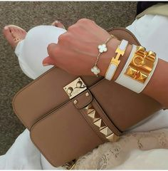 Valentino bag, Hermes CDC, Hermes Clic Clac, Van Cleef and Arpels Alhambra bracelet, and Chanel sandals.