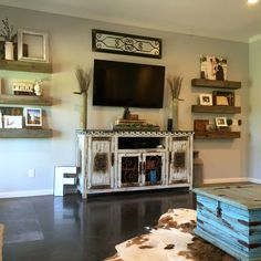 barnwood shelves, floating shelves, rustic decor, cowhide rug, farmhouse, decorating around a tv