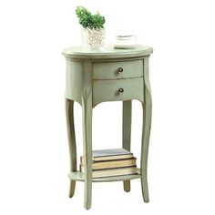 Infuse country-chic style into your home with this charming wood end table, featuring an antique green finish and cabriole legs.   P...