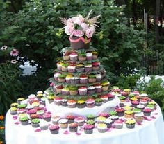Like the idea of a bride and groom cake and then the rest cupcakes! Would make it much less of a pain to serve!
