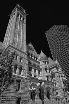 Looking up at the Old City Hall in Toronto in black and white.
