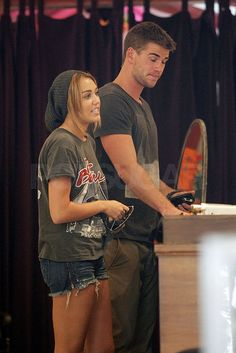 ~Liam Hemsworth escorted Miley Cyrus on a shopping trip. (Aug. 2011) Image Source: Pacific Coast News Online~